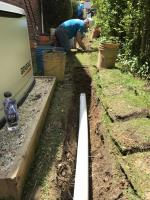 Installation of a lateral pipe from header line into home.