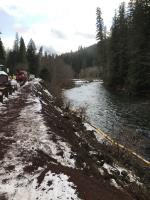 Initial boom placement in North Santiam River adjacent from wreck and spill, view upstream