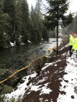 Initial boom placement in North Santiam River adjacent from wreck and spill; view downstream