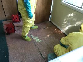 ERRS placing sulfur to remove elemental mercury beads from subfloor.