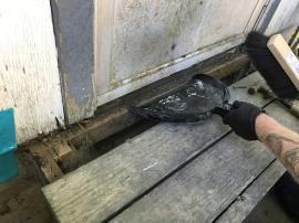 ERRS removing mercury contaminated debris from entrance deck and door threshold.