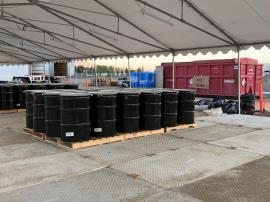 Staging - black barrels in staging tent.jpg