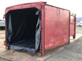 Staging - red plastic lined roll-on container.jpg