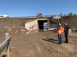Runoff on eastside of I-25 N turns west into the box culvert and enter surface drainage on westside of I-25 S.