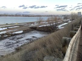 View of drainage ditch following removal efforts of impacted soil and water along I-25 South
