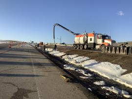 Contractor removing impacted material from drainage ditch between I-25 North and Frontage Road