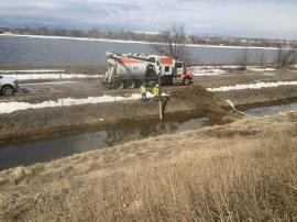 Removal of diesel fuel-impacted water in drainage ditch west of I-25.