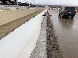 Water runoff gutter on  the east side of I-25.
