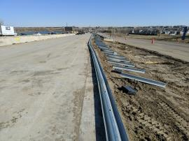 Installation of the gaurdrail along the east side of I-25 North.