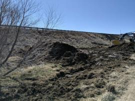 Berm constructed immediately north of primary excavation area west of I-25 South.