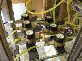 Flow meters showing injection rates into each well.