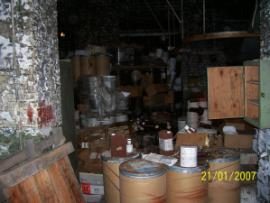 Improperly stored hazardous materials in former cotton mill.