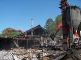 Demolition of former facility continues; viewed from west to east