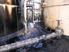 Contamination on the tank that ruptured and on the ground in the Davis Tank Battery.