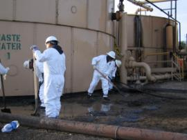 Greka employees cleaning up the tank farm