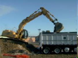 Loading truck for transport of soil to a certified landfill