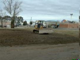Grading of the backfilled area using a bulldozer.