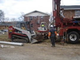 Drillers installing a dewatering well.