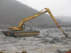 Amphibious backhoe excavating a trench to allow water flow from slough to the Emory River.<br />Date Taken: 1/3/2009<br />Category: <br />Latitude: <br />Longitude: <br />Tags: