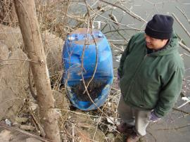 OSC Inspecting abandoned drum on riverbank Cal Sag channel
