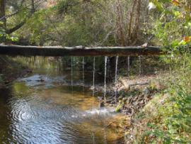 Discharge pipe of treated mine water into Little Fork Creek