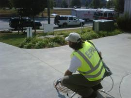 EPA OSC conducting air monitoring at sewer manhole