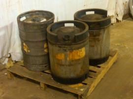 Staged stainless steel drums of pure nitric acid.