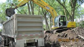 Loading Trucks with stabilized soil for disposal at Landfill