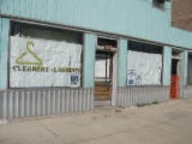 View of Front Entrance of Former Sandies Dry Cleaner and Laundry Facility