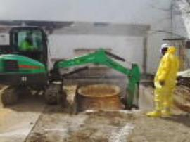 ERRS mix drying agents into sludge in pit W-21 and poly tank W-14