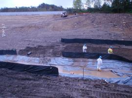 Construction of temporary stormwater conveyance at the upstream end.