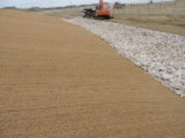 Completed installation of the GEO coir and water drainage on the south side of temporary consolidated waste pile