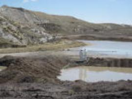Crew servicing de-watering pump leading to evaporation ponds.  These ponds are dug within tailings (already contaminated therefore will not be further contaminated by the water).<br />Date Taken: 5/1/2013<br />Category: Site Photo<br />Latitude: <br />Longitude: <br />Tags: