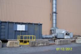 Vent from contaminated soil processing building to filter device (center).