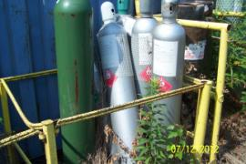 Cylinders of hydrogen gas, acetylene gas, and oxygen staged together.