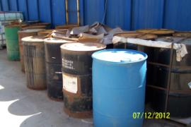 Drums of unknown chemicals staged at the Site.