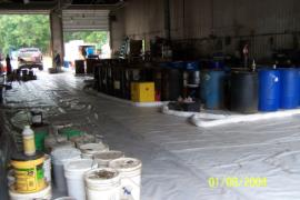 Containers of known contents staged in new area, view looking towards front entrance.