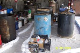 Containers of known chemicals staged by chemical characteristic.