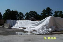 Covered and secured fly ash pile.