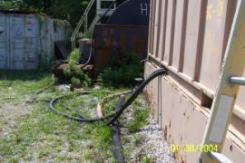 Hoses running from carbon filtration device leading to sewer discharge.