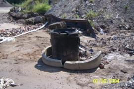 Dry well set up at base of contaminated soil stockpile.
