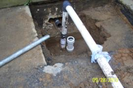 Section of broken pipe (downcomer) ready for repairs.