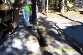 Crew using vac truck to clean out in-plant drains to reduce flooding.