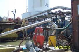 Double diaphram pump (center) moving standing water into Tank #17 (background) to raise oil in tank to an accessable level for removal.