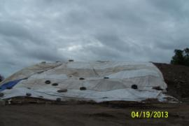 Re-covered contaminated soil pile.