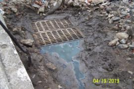 Diminished leached flow from contaminated soil pile.