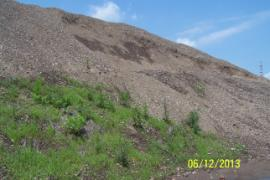 Area of soil pile showing landslide off main pile as a result of excessive rain.