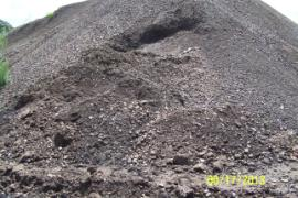 Additional soil pile subsidance from excessive rainfall.