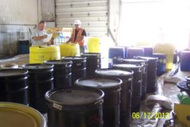 ERRS crew cleaning and labeling drums for shipping on 6/19.