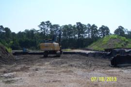 Bermed staging area in soil pile area that will be used to contain dredged sediment from retention ponds.